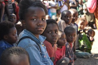 Young Girl Listens to Reproductive Health Messages Through Drama, Chilanga