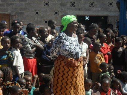Community Based Organisation Leader Addresses the Crowd on Unsafe Abortion