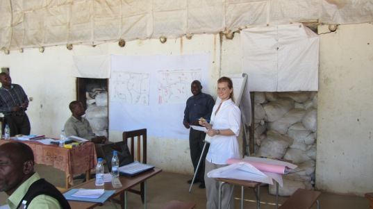 Gabriella facilitating community mapping exercise with community leaders. Zambia gold client