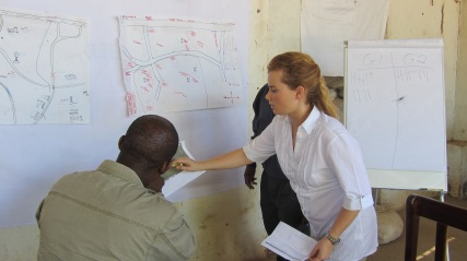 Leading Senior Headman through a community mapping exercise during Capacity Building workshop GDM Africa held for community leaders. (Australian Gold client)